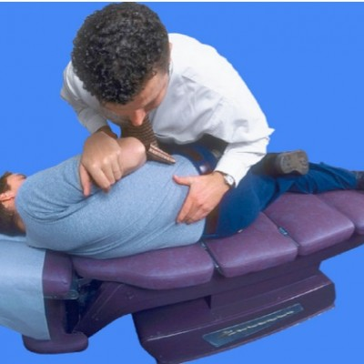 chiropractor adjusting spine in chair